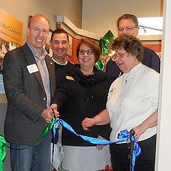 Deputy Mayor Jason Whalen cuts the ribbon, accompanied by County Council Chairman Doug Richardson and City Council Members Marie Barth and Paul Bocchi.