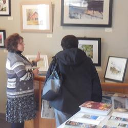 Kathy shows a visitor her work at our kick-off reception on Dec. 9