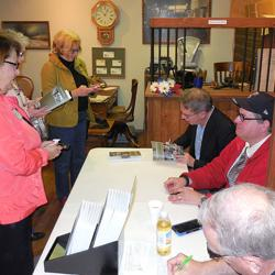 Noted local author/historian team Neary and Dunkelberger signing copies of their latest book.