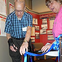 Saturday, May 9: Bill Charlton cuts the ribbon to officially open the exhibit.
