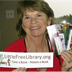 Bonnie Magnusson with Little Library promotional materials.