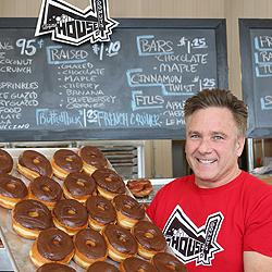 Tom Peterson with a tray of House of Donuts' finest.