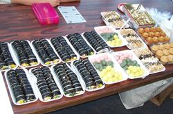 Korean sushi and other goodies, free for the sampling.