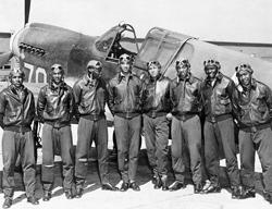 Tuskegee Airmen with trainer aircraft.