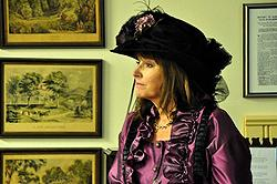 Peggy Gross, current owner of the mansion, in appropriate Victorian finery.