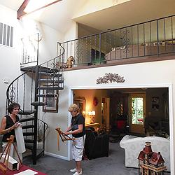 …until you're inside. Spiral staircase leads from living room to what was once the hayloft.